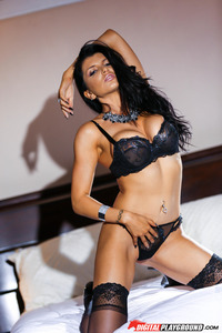 Romi Rain Stripping In Her Bed