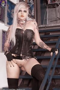 Tattooed Girl In Leather Corset