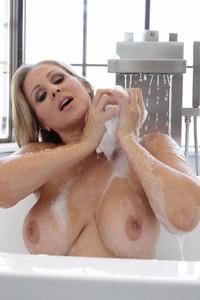 Julia Ann Strips And Takes A Bath