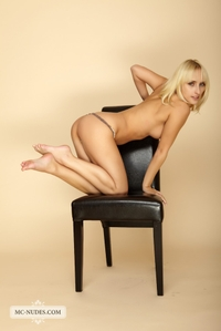Colette shows off her body on chair