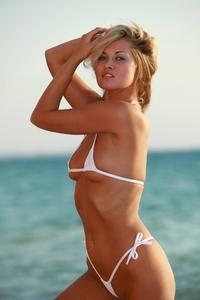 Blonde Rebeca in white bikini