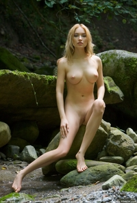 Gorgeous blonde Lia naked in the forest