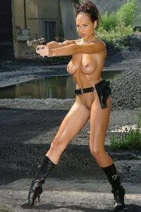 Sexy slut playing with a gun