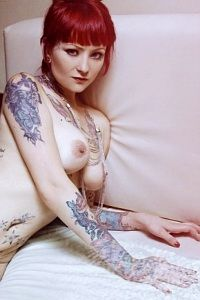 Tattooed redhead naked Krito in bed