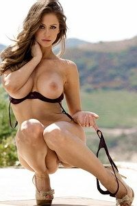 Cheeky Emily Addison teasing outdoor