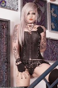 Tattooed Girl In Leather Corset