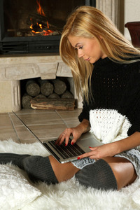 Peneloppe Ferre is enjoying some time with her laptop